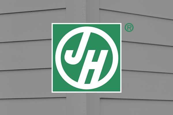 James Hardie siding logo on home siding background