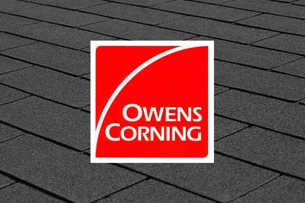 Owens Corning Logo on roofing shingles background