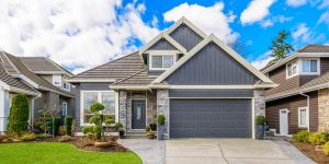 Front of home with great roofing and siding color combination