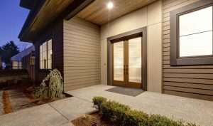 Front of home with brown fiber cement siding