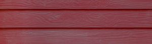 Close up of red fiber cement siding for background