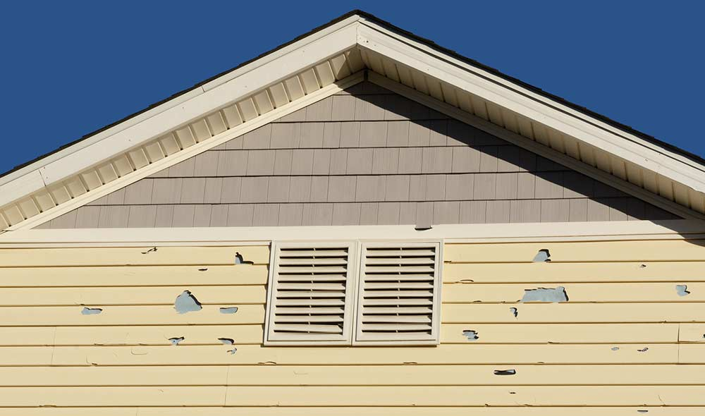 Home with hail and storm damage in need of repair