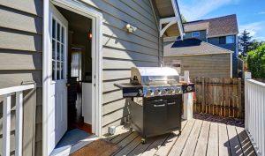 Vinyl siding installation on back porch of home