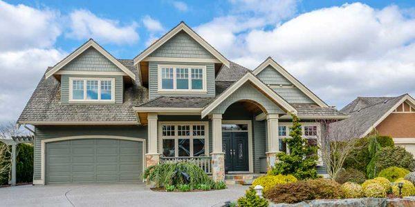 beautiful suburban home featuring greg hardie siding abd wood patterned shingles
