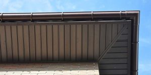 beautiful dark oak textured fascia and soffit combination displayed with an under-head point of view