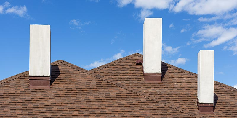 perfectly placed roof shingles with a beautiful blue sky background